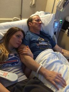 Jim Kelly and his daughter at the hospital